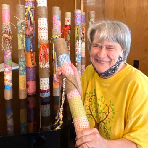 Resident receiving fabric swatches as a gift at Canoe Brook Assisted Living in Ardmore, Oklahoma