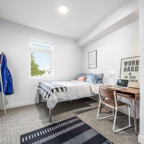 Bedroom with a study space at University Park in Boca Raton, Florida