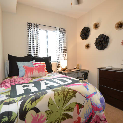 Cute bedroom with wall décor to match the room at University Park in Boca Raton, Florida