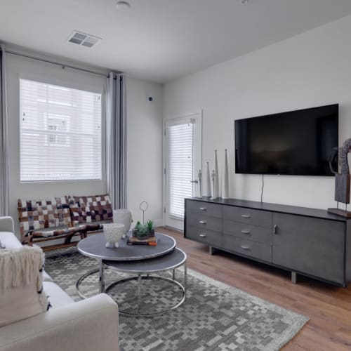 Well-furnished living space in a model home at Olympus Rodeo in Santa Fe, New Mexico