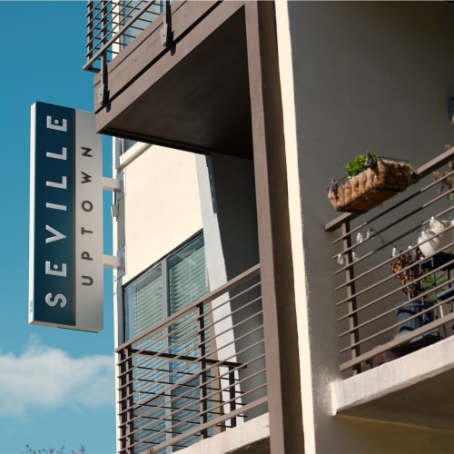 Exterior building sign at Seville Uptown in Dallas, Texas
