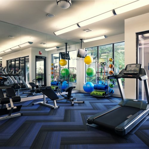 Full sized fitness center at Seville Uptown in Dallas, Texas