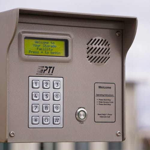 A keypad to open the gate at the entryway of Red Dot Storage in New Palestine, Indiana