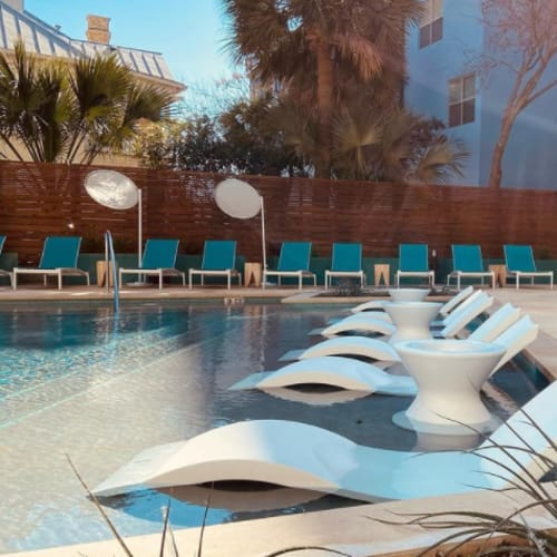 Outdoor lounge seating by pool at Heritage Plaza in San Antonio, Texas