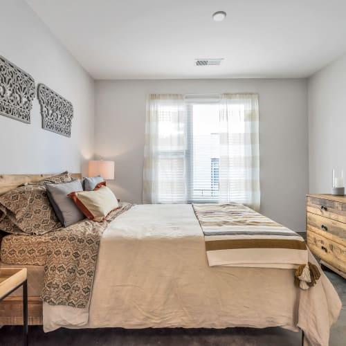 Well-lit bedroom at Gantry Apartments in Cincinnati, Ohio