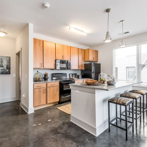Kitchen area with lots of cabinets at Gantry Apartments in Cincinnati, Ohio