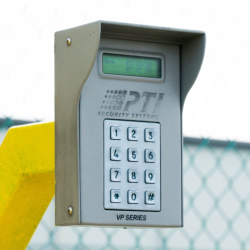 Secure entry keypad outside storage units at Red Dot Storage in Port Allen, Louisiana