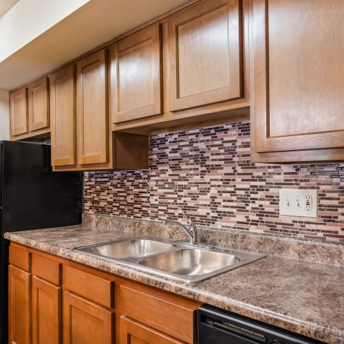 Lots of cabinets in a kitchen at Thirty43 by the Greene in Kettering, Ohio
