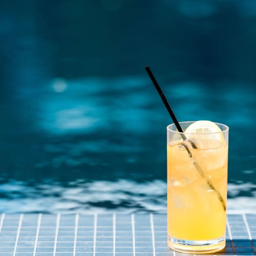 Refreshing cocktail by the pool at Hawthorne Hill Apartments in Thornton, Colorado