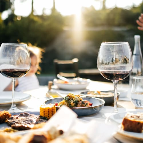 An outside table set for dinner, near Hawthorn Village Apartments in Napa, California