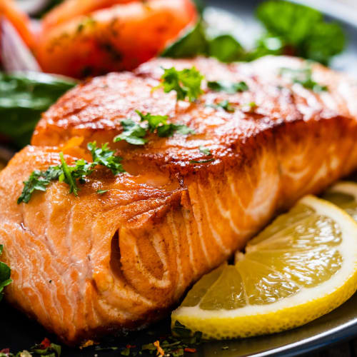 Seared salmon steaks at a world-class seafood restaurant in Seattle, Washington