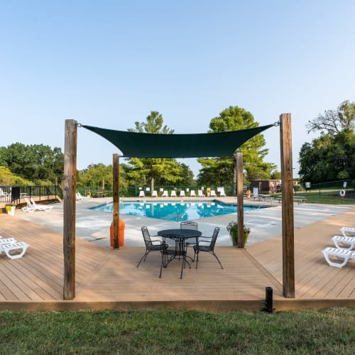 Outdoor seating and shade at Miamiview Apartments in Cleves, Ohio