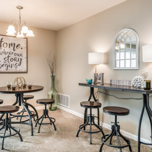 Lounge area with barstools at Miamiview Apartments in Cleves, Ohio