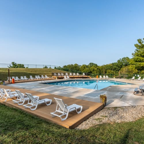 Swimming pool and deck chairs at Miamiview Apartments in Cleves, Ohio