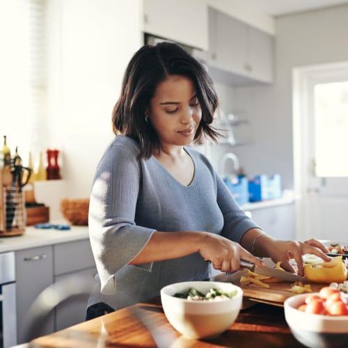 Resident making breakfast at Laurel Ridge in Northampton, Massachusetts