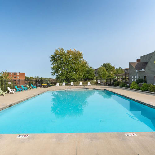 A large swimming pool with plenty of lounge chairs at Vantage Pointe West Apartments in Cincinnati, Ohio
