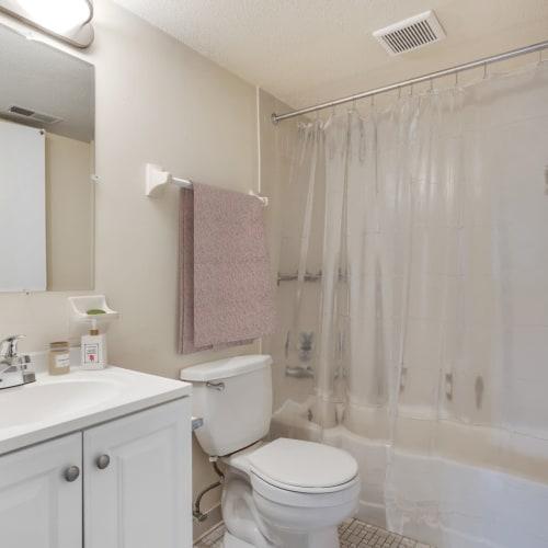 A bathroom with an oval tub at Vantage Pointe West Apartments in Cincinnati, Ohio