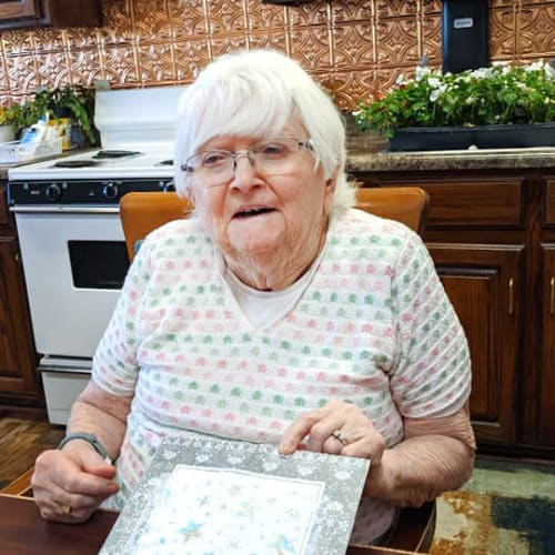 A resident making crafts at Homestead House in Beatrice, Nebraska