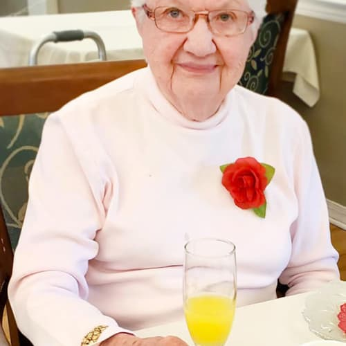 A happy resident with a drink at Homestead House in Beatrice, Nebraska