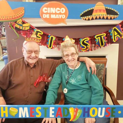 A happy resident couple celebrating Cinco de Mayo at Homestead House in Beatrice, Nebraska