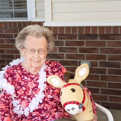 Resident with a horse toy at Homestead House in Beatrice, Nebraska