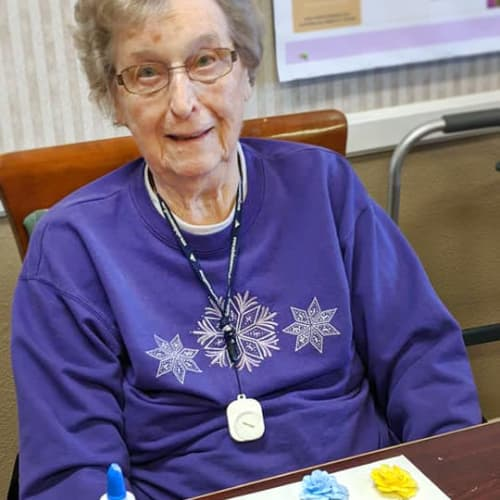 Resident with craft project at Homestead House in Beatrice, Nebraska