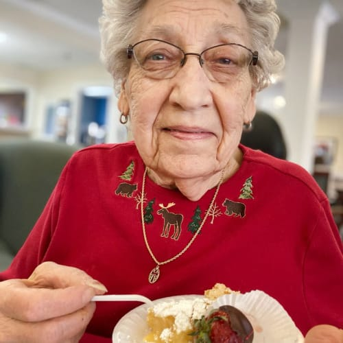 Resident enjoying cake at Madison House in Norfolk, Nebraska