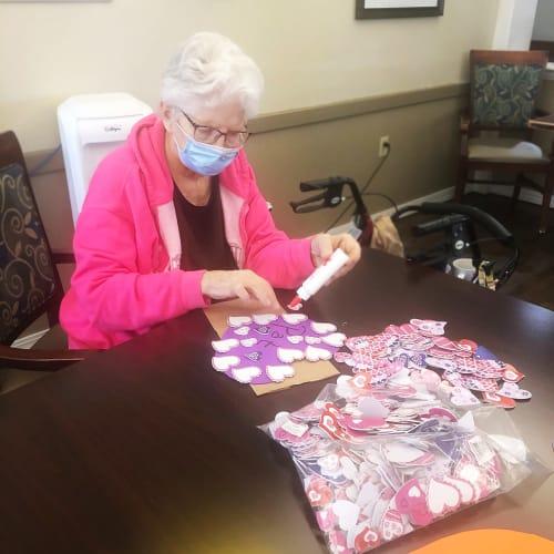 Resident making Valentines Day crafts at Madison House in Norfolk, Nebraska