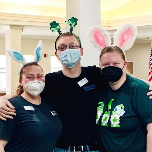 Caretakers in bunny ears celebrating Easter at Madison House in Norfolk, Nebraska