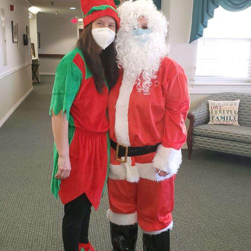 Two caregivers dressed as Santa and elf at Saunders House in Wahoo, Nebraska