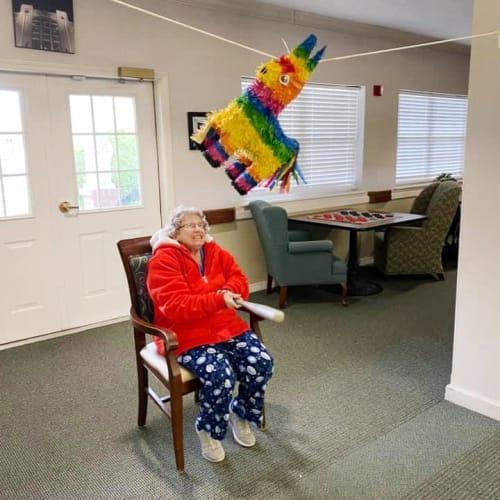 Resident with piñata at Saunders House in Wahoo, Nebraska