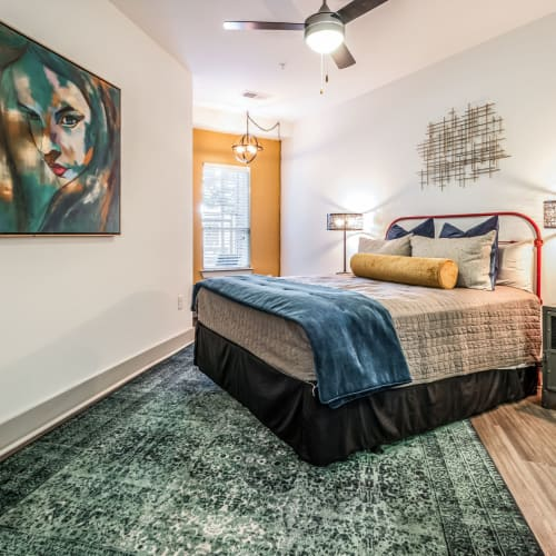 Cozy primary bedroom at Skyline West in Atlanta, Georgia