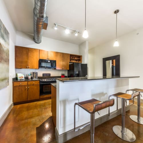 Fully equipped kitchen at Marquis Lofts on Sabine in Houston, Texas