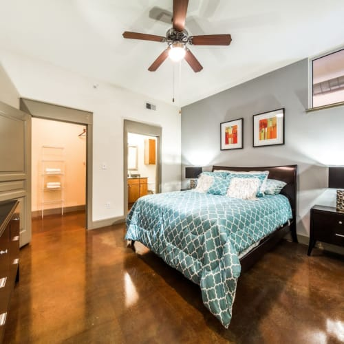 Cozy primary bedroom at Marquis Lofts on Sabine in Houston, Texas