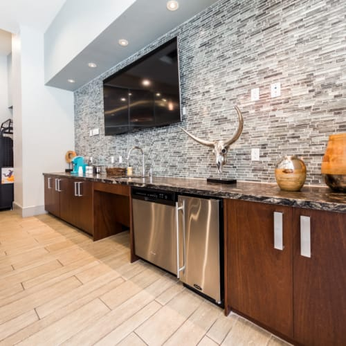 Large wall mounted television in community clubhouse kitchen at Marq on Burnet in Austin, Texas