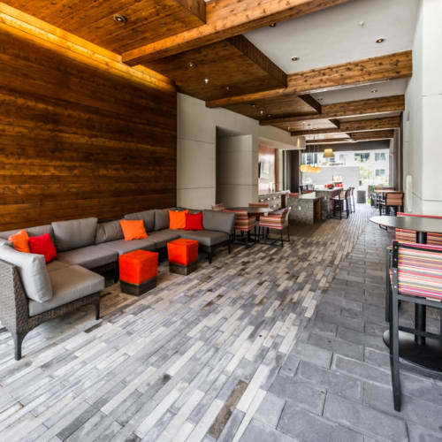 Thruway with lounge couches and dining bar tables and chairs of Marq on Burnet in Austin, Texas