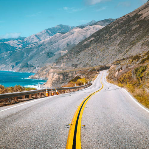 A road in along the California coast, on a sunny warm day.
