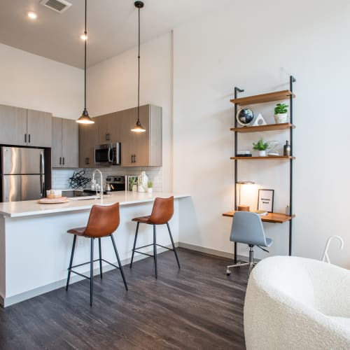 Living room and kitchen at Marq Iliff Station in Aurora, Colorado