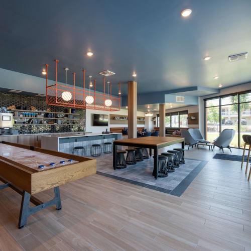 Clubroom with shuffleboard at Marq Iliff Station in Aurora, Colorado