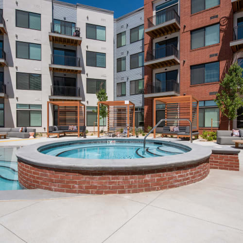 Hot tub by the pool at Marq Iliff Station in Aurora, Colorado