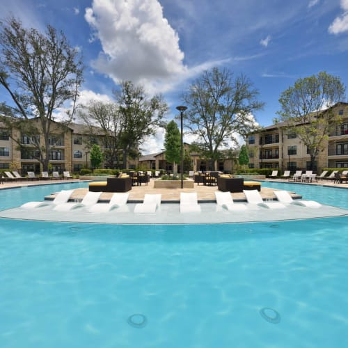 Spa and swimming pool area at Olympus Falcon Landing in Katy, Texas