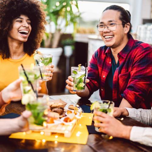 Friends enjoying drinks near Marq 211 in Seattle, Washington