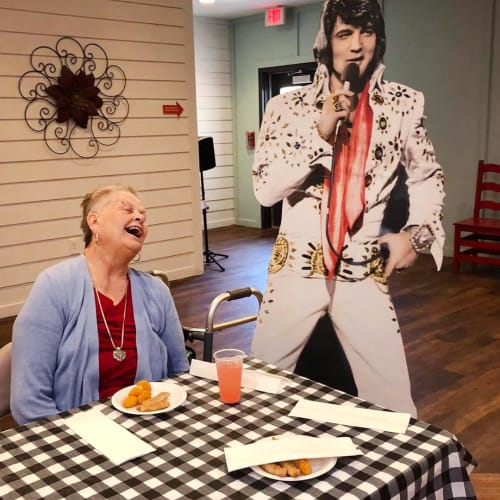 Smiling resident with elvis at Oxford Glen Memory Care at Sachse in Sachse, Texas