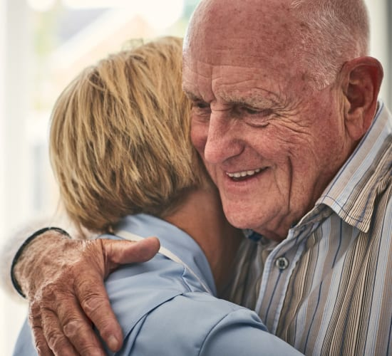 Residents embracing at Kenmore Senior Living in Kenmore, Washington