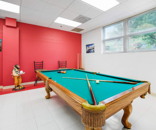 Game room with pool table at Warren Place Apartments in Cockeysville