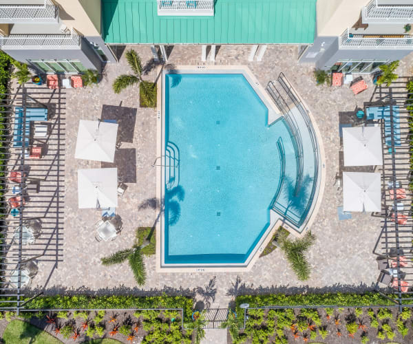 Resort-style swimming pool at All Seasons Naples in Naples, Florida