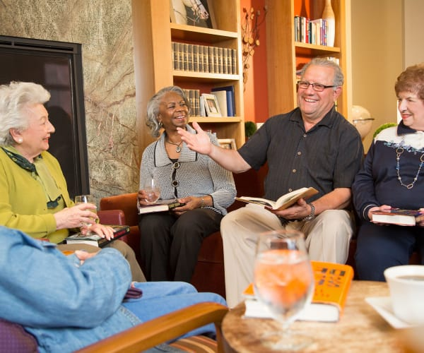 Residents at a book club meeting at All Seasons Naples in Naples, Florida