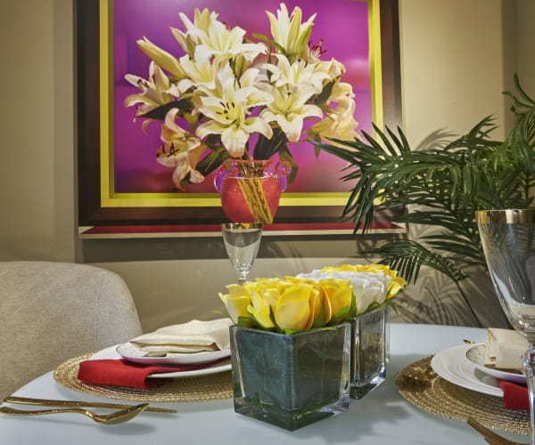 Dining room table with flowers at All Seasons of Rochester Hills in Rochester Hills, Michigan