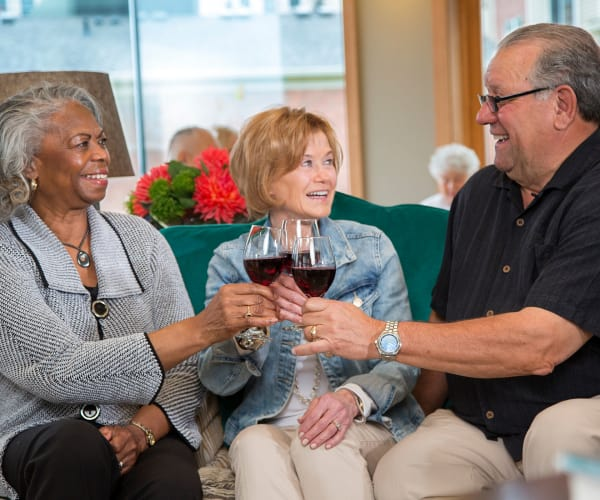 Residents chatting over some wine at All Seasons Rochester Hills in Rochester Hills, Michigan