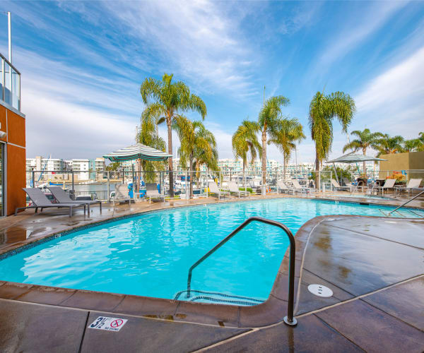 Beautiful pool and outdoor seating area at Harborside Marina Bay Apartments in Marina del Rey, California